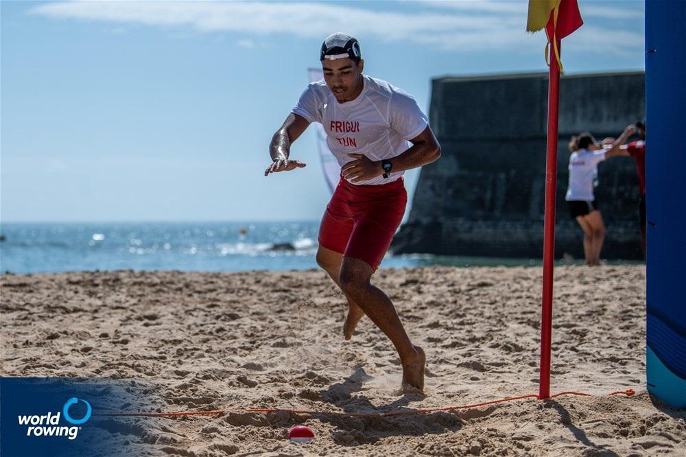 Bilel Frigui, Junior Men's Solo, Tunisia, 2021 World Rowing Beach Sprint Finals, Oeiras, Portugal / World Rowing/Benedict Tufnell
